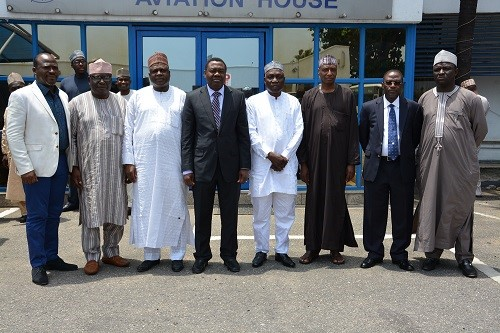 L-R ICAO helmsman, Dr. B.O Aliu (4th L) in a group photograph with CEOs of Aviation Agencies as led by DG, NCAA, Capt. Muhtar Usman (3rd L) after their meeting at the Aviation House...recently