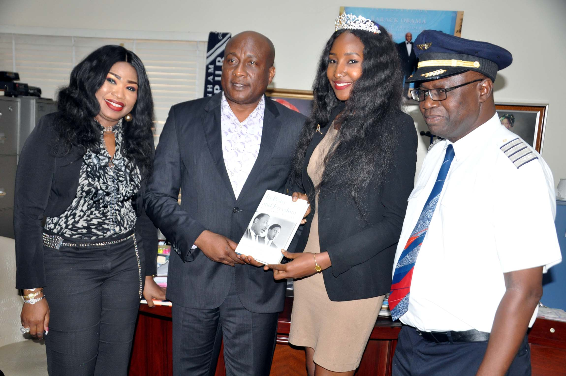 """Air Peace Ambassador, Miss. Nigeria 2015, Leesi P. Peter-Vigboro, (3rd left) receiving copy of a book """"None Violent"""" from Chairman, Air Peace, Allen Onyema (2nd left), Chief Operating Officer/Managing Director, Miss. Oluwatoyin Olajide (left) and Director of Flight Operations, Capt. Wellington Eyimina during Miss. Nigeria's courtesy visit to Air Peace in Lagos"""