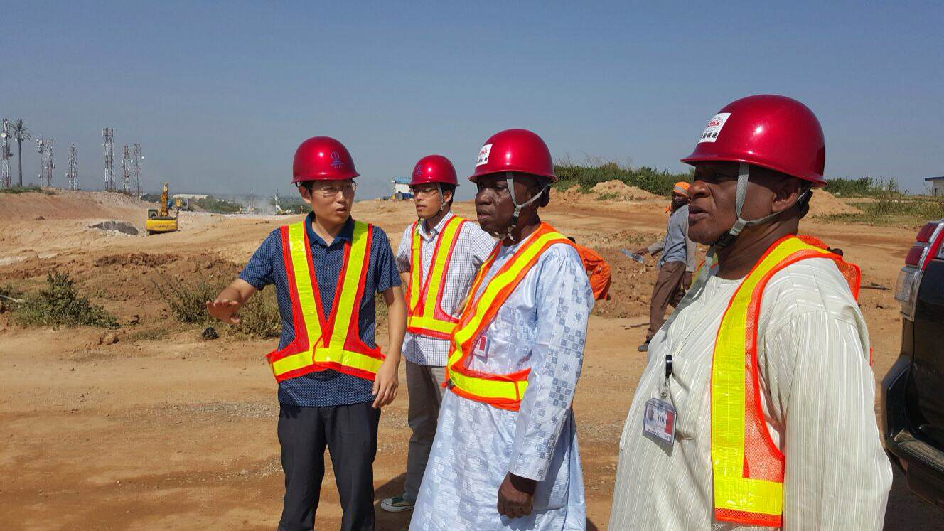 L-R King Qin Cheng Ming of CCECC, Managing Director, Federal Airports Authority of Nigeria, Engr Saleh Dunoma and Airport Mukhtar Mohammed, Airport Manager, Nnamdi Azikiwe International Airport Abuja.