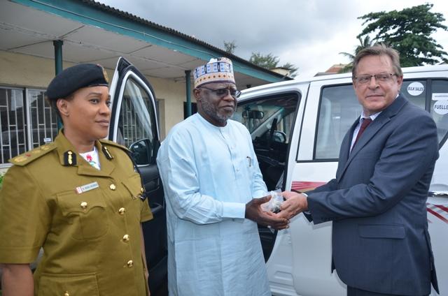 US Consul General Mr. John Bray presenting keys to NDLEA chairman, Muhammad Abdallah with DG, Mrs. Roli Bode George