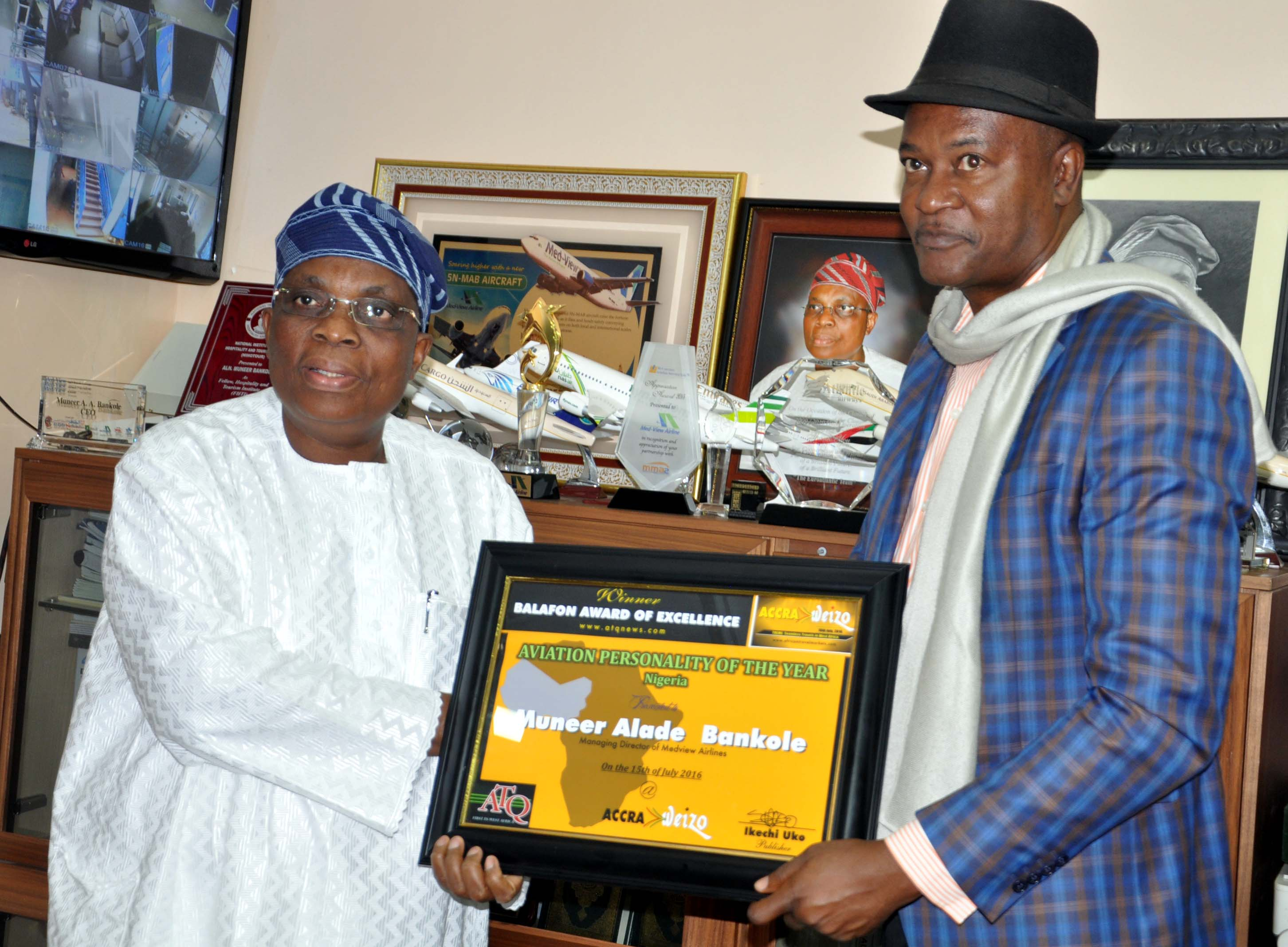 """Managing Director/Chief Executive, Med-View Airline Plc, Alhaji Muneer Bankole (left) receiving fromTourism Ambassador, Ikechi Uko, the """"Aviation Personality of the year 2016 Nigeria, (Balafon Award) at the 2nd Weizo travel and tourism conference and exhibition in Accra, Ghana."""
