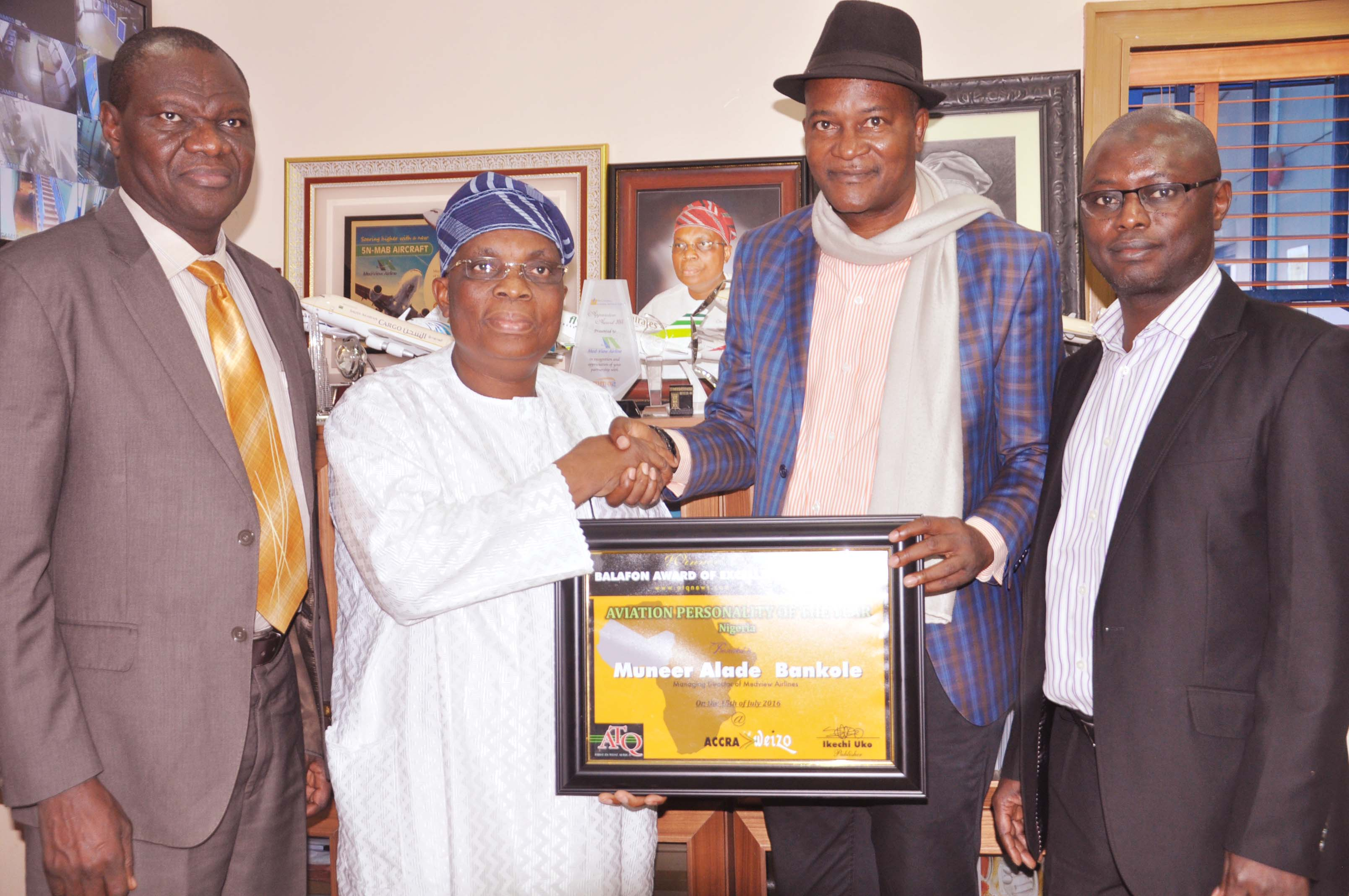 """Managing Director/Chief Executive, Med-View Airlines, Alhaji Muneer Bankole, (2nd left) receiving the """"Aviation Personality of the year 2016 Nigeria, award (Balafon Award) at the 2nd Weizo travel and tour conference and exhibition in Accra, Ghana from the Organiser, Mr. Ikechi Uko, (3rd left). Others from left, Executive Director, Technical, Med-View Airline, Engr. Lookman Animashaun and far right, Executive Director, Business Development, Med-View Airlines, Alhaji Isiaq Na'Allah."""