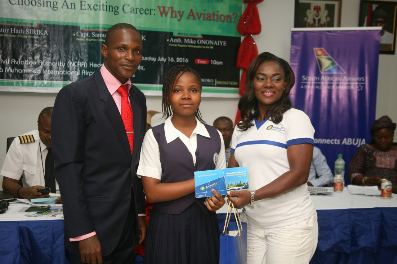 L - R) Mr. Ewos Iroro, Founder, NTEC; Miss Otti Faustina, a student of Barachel Model College, Olambe, Ogun State, Winner, Secondary Schools Category, NTEC 2015/2016, being presented with a free ticket to Kigali by Mrs. Genevieve Fiewor, Corporate Sales Executive, RwandAir.