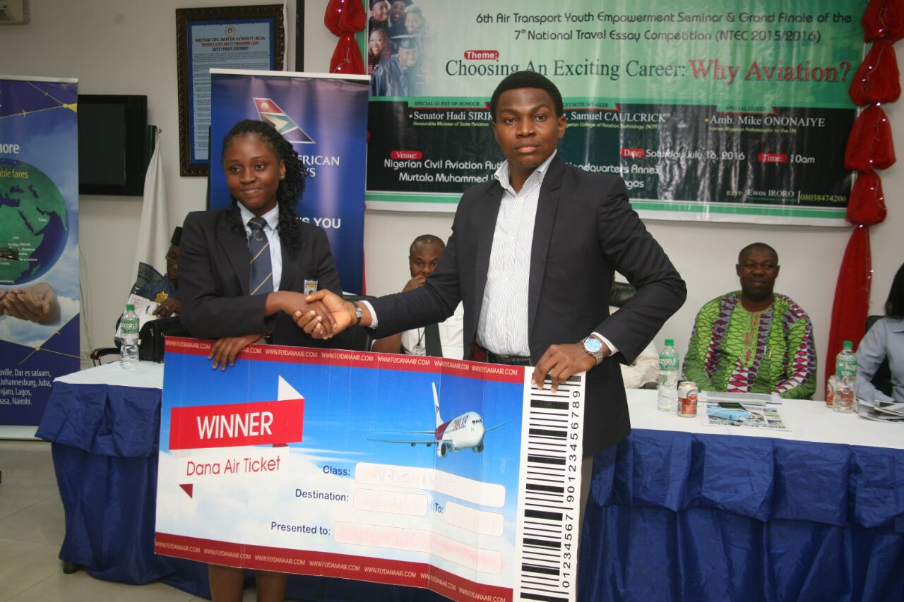 R-L:  Kingsley Ezenwa, Dana Air's Communications Manager, presenting a ticket to Ekuma Oma, a student of Princeton College and 3rd place winner (secondary school category) of the National Travel Essay Competition.