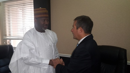 L-r: Minister of State for Aviation, Senator Hadi Sirika in a warm handshake with the United Nations-Appointed Project Manager for the schools, Douglas Melvin in his office in Abuja.