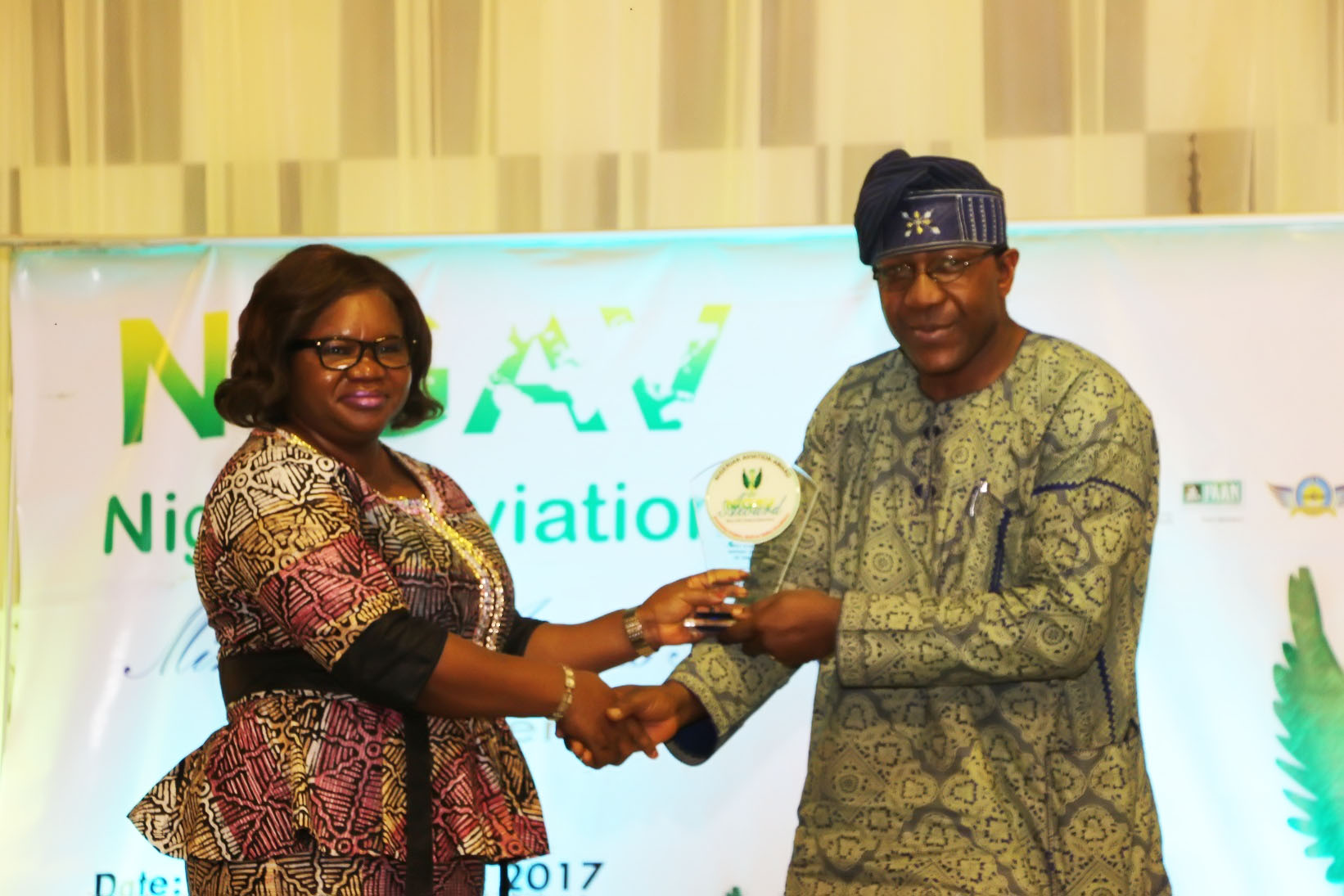 Legal Adviser, Nigerian Airspace Management Agency (NAMA), Mrs. Anastasia Gbem, presenting the award of the Most Functional Terminal of the Year (2016) won by the Murtala Muhammed Airport Terminal Two (MMA2) to the Head, Corporate Communications, Bi-Courtney Aviation Services Limited (BASL), operator of MMA2, Chief Stephen Omolale (left), who represented the Chief Executive Officer, Captain Jari Williams, at the award ceremony held in Lagos at the weekend.