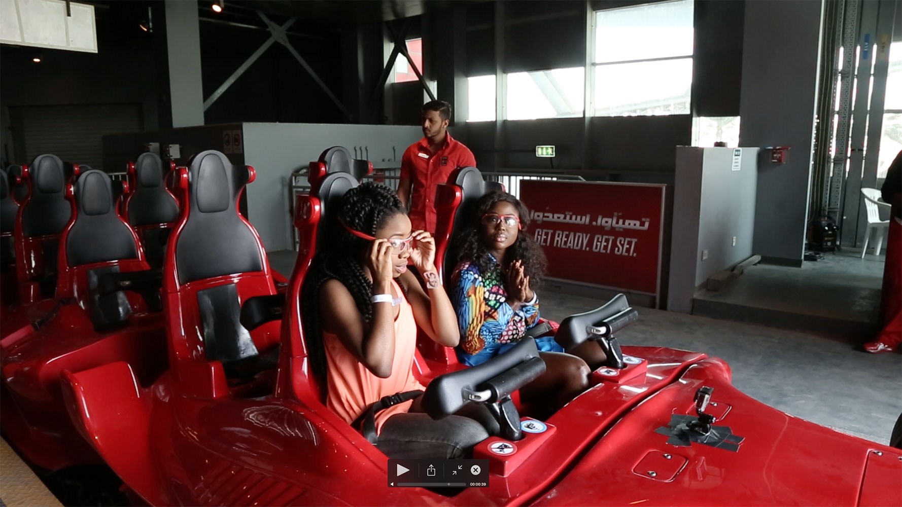 """Agharese Emokpae, Prize Winner and Sika Osei, Presenter of """"53 Extra"""" strap themselves in for the world's fastest roller coaster rides at Ferrari World Abu Dhabi."""