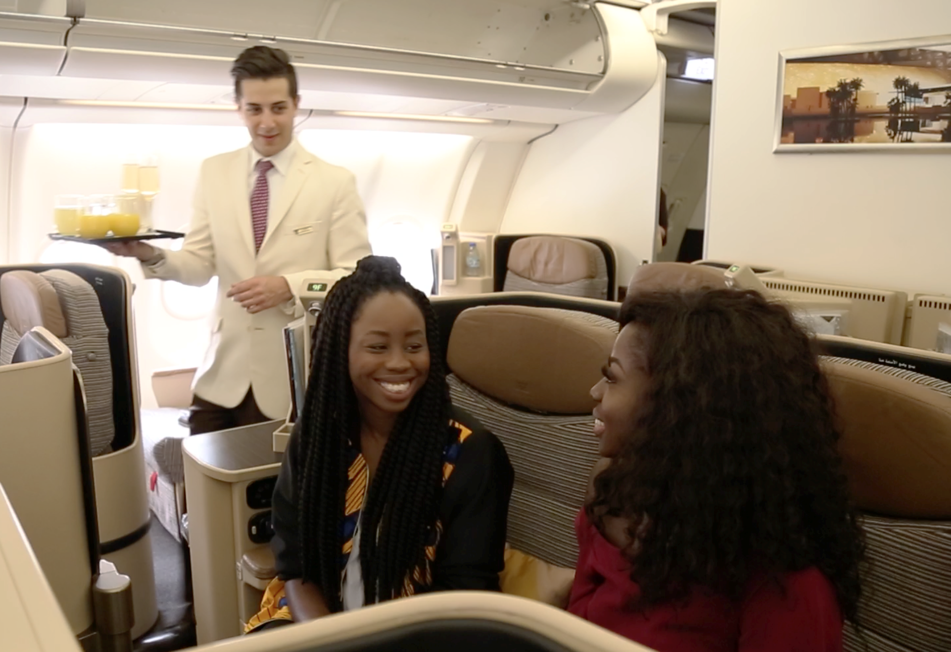 """L-R) Agharese Emokpae, Prize Winner, and Sika Osei Presenter of """"53 Extra"""" relax in style in Etihad Airways Business Class on their way to Abu Dhabi."""