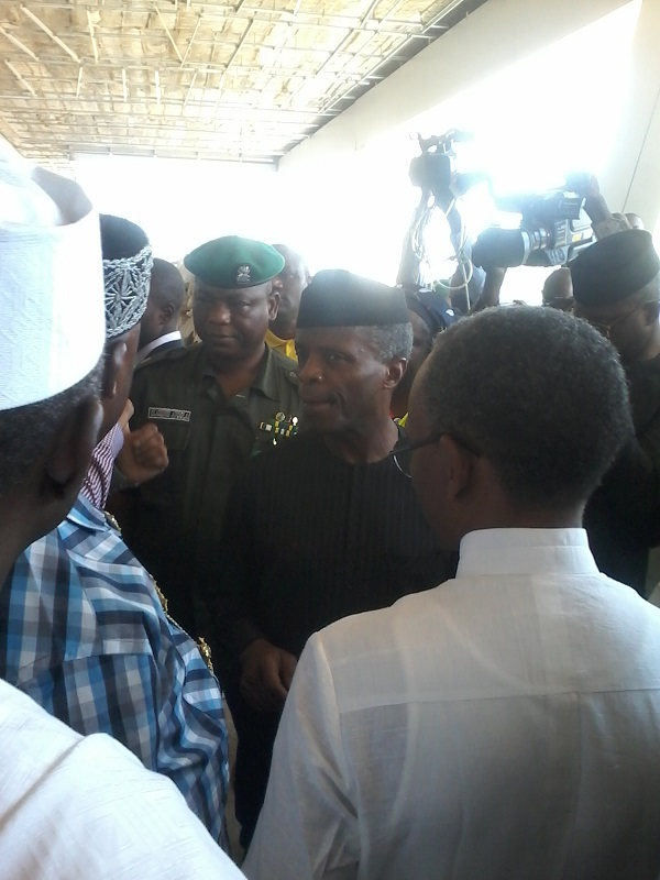 Osinbajo flanked by Amaechi and El-Rufai, being briefed by aviation agencies officials at Kaduna airport