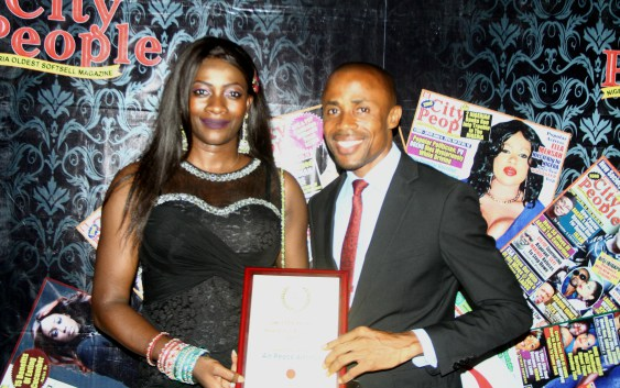 Air Peace Cabin Services Manager/Head of Commercial, Florence Opia and Corporate Communications Manager, Chris Iwarah displaying the Airline of the Year Award during the 20th edition of City People Award of Excellence in Lagos on Sunday.