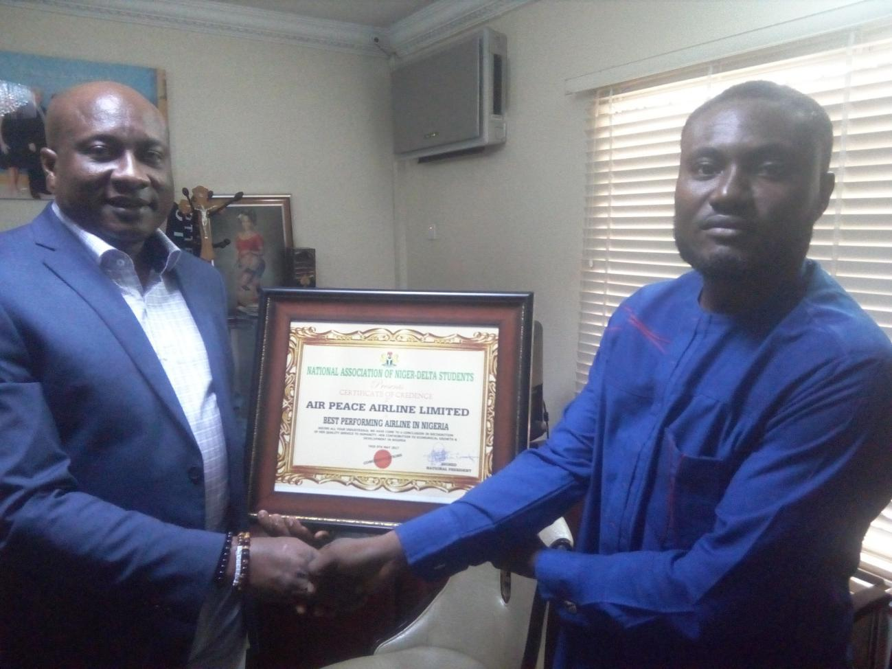 Air Peace Chairman/Chief Executive Officer, Barr. Allen Onyema (left) receiving the 'Best Performing Airline in Nigeria' award from the National President of the National Association of Niger-Delta Students, Comrade Martins Abebe at the airline's corporate headquarters in Lagos recently.